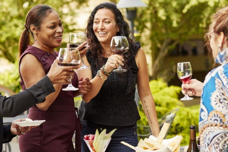 Three women participate in a wine tasting with Chief Wine Officer Mary Watson DeLauder