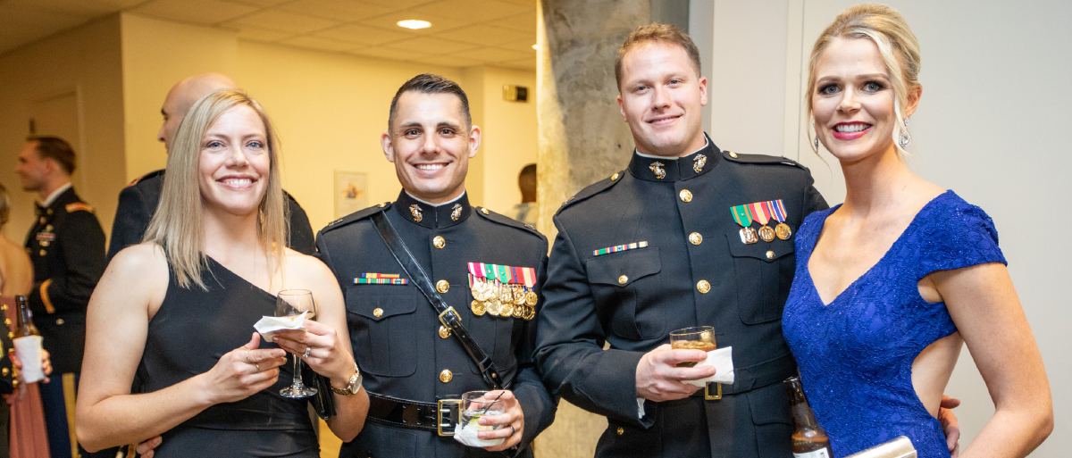 Two young couples pose at a military ball held at West Belmont Place
