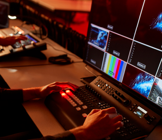 A member of The National's on-site IT/AV team, National Creative Productions, monitoring an event
