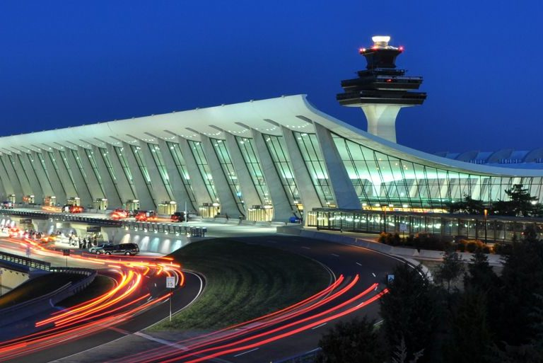 Dulles International Airport shown at night with a very active main terminal