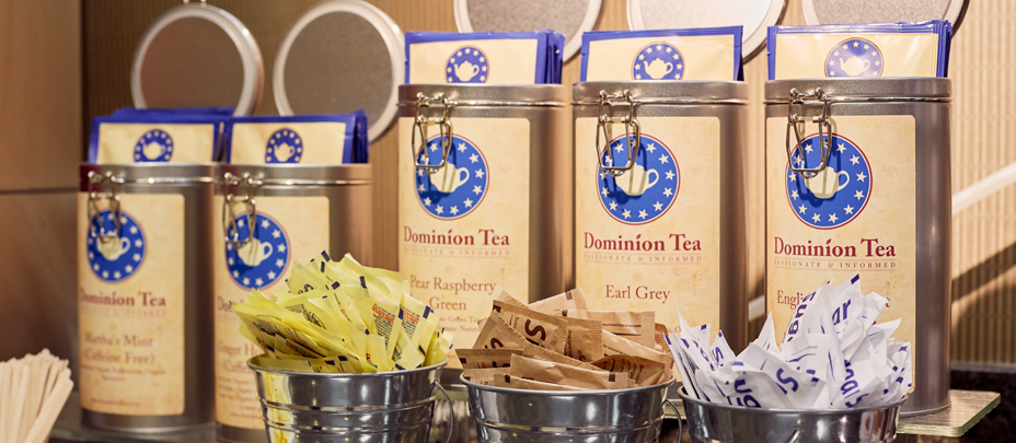 Canisters of Dominion Tea, one of The National's local partners, sit behind bowls of sugar packets