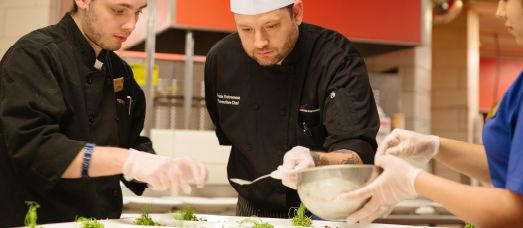 Executive Chef Frank Estremera prepares food for a culinary team building experience at The National