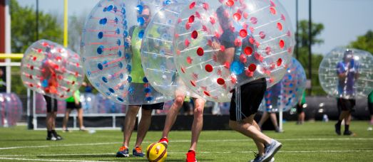 A team plays bubble soccer against one another in a offsite team building excursion