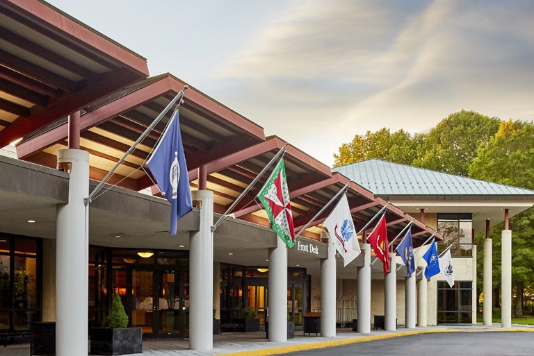Flags from a variety of countries hang on the outside of The National Conference Center
