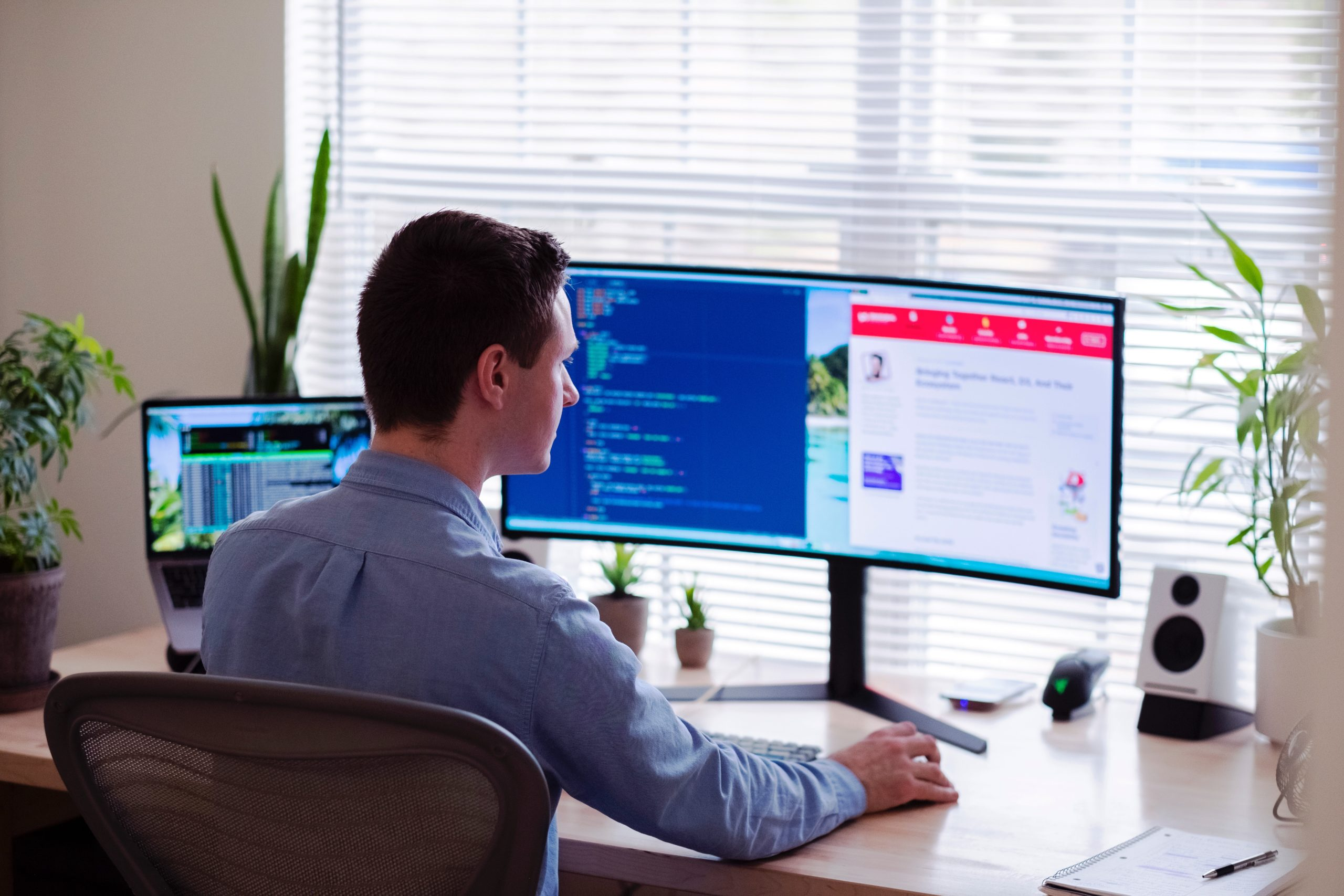 Man working from home on his computer at his desk